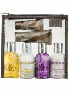 Molton Brown Women's Traveller contains travel-size body cream, body wash, conditioner, shampoo, hand cream, and scrub
