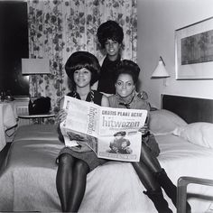 The Supremes in 1964, reading about themselves in the paper.