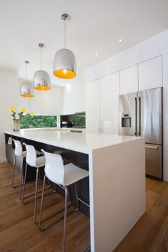 The kitchen is the heart of the home, compliment it with a crisp white light. #lightmatters