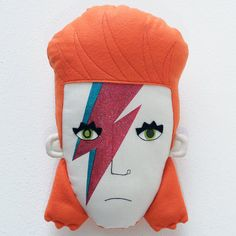 Ziggy played guitar! He is completely handmade and made of cloth, you can hang him on the wall like a picture.  David Bowie/Ziggy Stardust is 24cm tall.  ATTENTION: This pillow is made to order. Please expect at least 5 days from your order because Ziggy must be sewn. Thank you