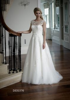 Annabell- Lace and tulle a-line wedding gown, with illusion neckline and low back. Detachable belt detail pulling in the waist. Beading detail adds a touch of sparkle to the lace. Zip back.  The dress is available with or without a layer of sparkle tulle under the skirt.