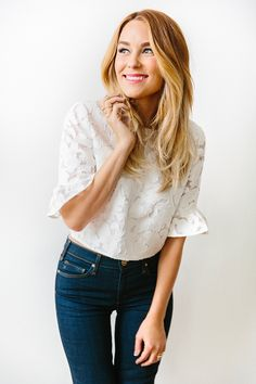 Lace top and flared jeans on Lauren Conrad