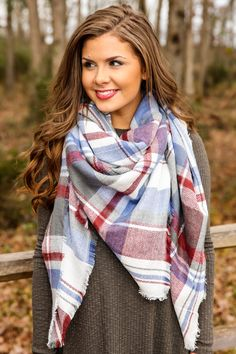 "It's no secret that you cannot help but ""Do Tell"" everyone who looks your way about this scarf! Bold and bright, who wouldn't want to hear what you have to say! And then there's the scarf itself, fringed and full of cheer that each time you have her on, the story and your look are sure to get all the more exciting!! Plaid blanket scarf with fringe on the ends. 100% Acrylic. Wash by hand in cold water. Lay flat to dry. Made in China. Length measures 60"" Width measures 60"""