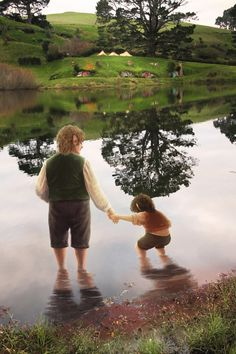 Lake Wading by Atarial on deviantart. Aww! Friendly reminder that Frodo's parents drowned, so he most likely was afraid of the water for a while.