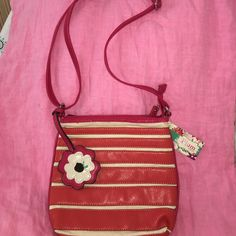 👛NWT shoulder bag On SALE ‼️ Orange,dark pink ( almost red), off white Cross body bag with long strap ! Has a sweet flower attached 🌺 Non-smoking household 🌺 This would make a great gift !!!!! PRICE FIRM ! Plum by LaTique Bags Crossbody Bags
