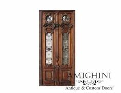 Magnificently tall and meticulously crafted, these antique doors with gorgeous wrought iron details make an impressive entrance. #antiquedoors #curbappeal #amighini