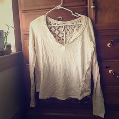 Free People Cream Long Sleeve Shirt Free People long sleeve shirt. Light weight material with a Lacey see through back. Front is a v-neck. Only worn a few times!! Free People Tops Tees - Long Sleeve