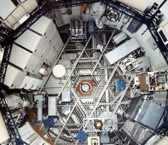 Skylab Orbital Workshop-  interior view of the orbital workshop upper level was visible from the airlock hatch. The octagonal opening separated the workshop's two levels. I From Above May 1972