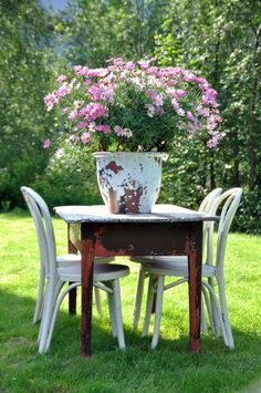 Love this no nonsense table and chair set. I would place a smaller container of herbs on the table.