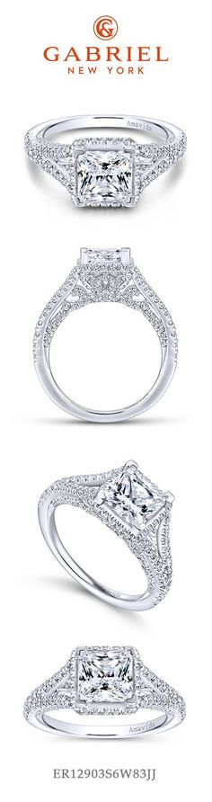 18k White Gold Princess Cut Halo Engagement Ring. Bright pave diamonds line the gallery and split shank band of this alluring engagement ring. An unconventional halo lines the perimeter of the princess cut center stone.