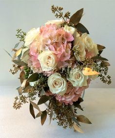 Pink and Gold Bouquet. Pink Hydrangea, Gold Eucalyptus, and White Roses.