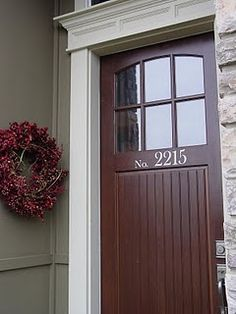 Add chunky trim around front door...the house numbers.
