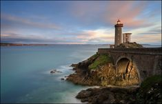 Phare du Petit Minou lighthouse in Plouzané, on the often stormy coast of Brittany in northwestern France Before I Die, Tower Bridge, Brittany, Lighthouse, Seaside, Bing Images, To Go, Coast, Bucket