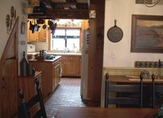 Homey kitchen floor with Wright's Ferry brick tiles. Marietta color mix.