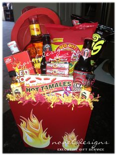 Red Hot Fire Gift Basket Contains: Fireball Whiskey, Inferno Corn Chips, Red Hot Pork Rinds, Fireman Brew, Hot Sauce & More. Topped w/Fireman Helmet Valentine Gift Baskets, Valentine Gifts, Fireball Whiskey, Gift Baskets For Men, Firefighter Gifts, Auction Baskets, Raffle Baskets, Candy Bouquet, Cute Gifts