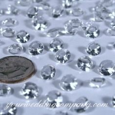 Add sparkle to your wedding reception tables with these clear, acrylic diamonds. This unique table confetti is perfect for an icy winter-wedding or diamond theme.