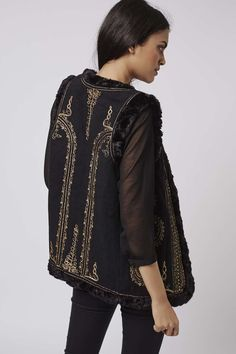 Partner this Metallic embroidered gilet with floaty silk shirts and dresses for a nod to 70s Bohemia. #Topshop