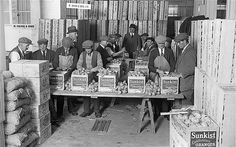 Fruit Market, October 1929 Wrapped oranges being packed into cartons at the London Fruit Exchange, Spitalfields. During World War I, food imports were inevitably reduced and home produce then attracted government subsidies throughout the 1920s and 1930s in an effort to balance the trade deficit. Oranges remained popular, however, and were traditionally stuffed into the toes of children's stockings at Christmas. Long-gone East End London - Telegraph