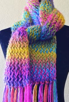 4cfc90ee131 Wrap yourself up in this beautiful hand knit multi-colored scarf. A perfect  gift for someone or for yourself! Add a touch of color to your wardrobe!