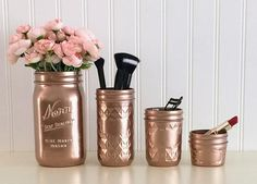 Organize your vanity with this beautiful mason jar set. These mason jars are rose gold metallic and include 4 jars. The large vase is quart size. The jars are painted and sealed on the outside. This listing is for the jars only. The flowers and accessories in the photo are not