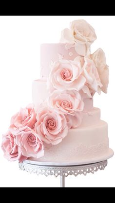 Pink wedding cake with flowers.