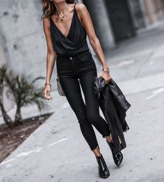wrap bodysuit, black step hem skinny jeans, black patent leather booties