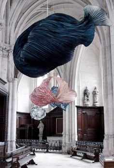 shape-shifting paper sculptures by Dutch artist Peter Gentenaar hang inside the Abbey Church of Saint-Riquier in France
