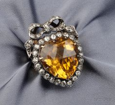 Citrine and Diamond Ring, centering a large rose-cut heart-shaped citrine with old mine-cut diamond frame and bow, silver-topped gold mount. [Silver topped gold mount makes it likely it's Victorian; Gems Jewelry, Heart Jewelry, Diamond Jewelry, Fine Jewelry, Jewellery, Antique Rings, Antique Jewelry, Vintage Jewelry, Diamond Rings For Sale