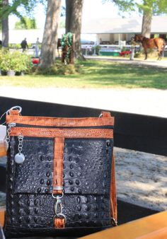 Italian Leather two tone handbag in black and saddle brown. Secure front lock and 2 zippered compartments and the crocodile print make it a very doable travel bag. Caracol - Inspired Jewelry and Handbags - Italian Leather Cross Body Bag Italian Leather Handbags, Stylish Handbags, How To Make Handbags, Travel Bag, Crocodile, Leather Crossbody Bag, Cross Body, Inspired, Black