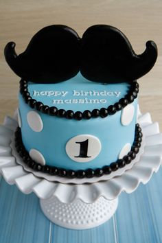 LITTLE MAN FIRST BIRTHDAY - A giant moustache cake to celebrate a big birthday for Massimo. Centrepiece of vanilla cake, chocolate buttercream, and marshmallow fondant.