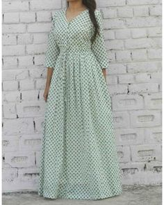 Buy The Secret Label Mint Cotton Printed string Kurti online in India at best price.Floor length maxi dress in soothing mint green tone. Stylish Dresses, Simple Dresses, Fashion Dresses, Simple Kurti Designs, Blouse Designs, Indian Designer Outfits, Designer Dresses, Cotton Gowns, Long Gown Dress