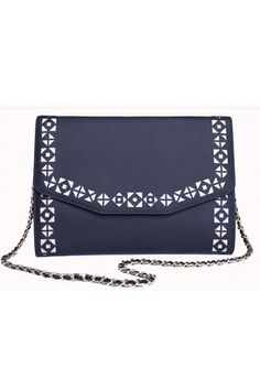 """Sophisticated and versatile, The Urban Story handcrafted leather clutch was inspired by the dinamic woman who loves an edgy look throughout any busy day or restless night, but needs to keep more than her essentials with her. Its perforated pattern is folklore inspired and gives a special flavour of """"je ne sais quoi"""" to any outfit. #busta #bustabags #leatherclutch #leather #streetstyle #perforated #blue #embroidery #folklore #handmade #clutch #metalstrap #metalchain"""