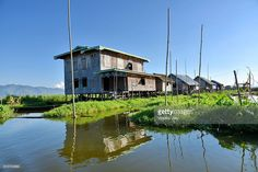 Reflection lake, house on stilts Inle Lake, Myanmar. Asia. #photo #photographer #photography #getty #images #travel #traveler #inle #inlay #lake #nature #landscape #houseonstilts #colored #burma #asia #house #wood #bamboo