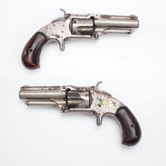 Smith & Wesson Model 1 ½ - Made between 1868 and 1875, it is chambered in .32 rimfire instead of .32 centerfire. Another difference between this Model 1  ½  and a later one is that it is a tip-up model instead of a top-break and the spent casings must be removed manually, one at a time. NRA National Firearms Museum in Fairfax, VA. http://goo.gl/qKs2eZ