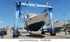 Thailand Phuket : 2015 November 26 ,yacht hauling out for repair at Phuket Boat Lagoon Marina in Thailand Phuket, Marina Bay Sands, Photo Editing, Thailand, November, Royalty Free Stock Photos, Boat, Building, Pictures