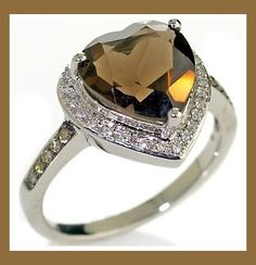 http://www.occasionsniagara.com/Portals/72883/images/chocolate-diamond-wedding-ring1.jpg