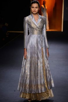 Rahul Mishra presents Ice Grey hand woven kamal jaal long pleated jacket with gold lehenga available only at Pernia's Pop Up Shop. Indian Gowns Dresses, Indian Fashion Dresses, Fashion Outfits, Indian Wedding Outfits, Indian Outfits, Heavy Dresses, Indian Designer Suits, Anarkali, Churidar