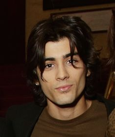 And they sit by his brown eyes and wave hello to your melting soul. | Zayn Malik With Long Hair Is The Most Perfect Version Of Zayn Malik