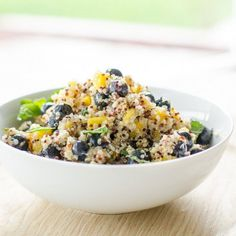 Bursting with flavor quinoa salad- blueberry, mint, mango and a tart dressing will have a party in your mouth.
