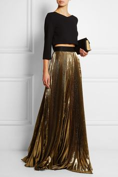 Faith Connexion | Pleated lamé maxi skirt | EDITORS' NOTES & DETAILS Faith Connexion demonstrates just how glamorous separates can be with this gold lamé maxi skirt. It's nipped in at the waist with a black elasticated band and finished with pleats for added shimmer and movement. Emulate the Resort '15 styling with a cropped top and heels.