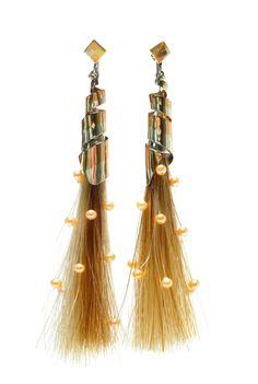 Very creative take on the tassel of horse hair.