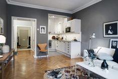 Un apartamento nórdico en gris y blanco