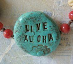 """Live Aloha (the other side should say """"live pono""""."""