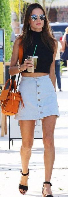 Who made  Alessandra Ambrosio's sunglasses, denim shirt, aviator sunglasses, watch, jewelry, and orange handbag?