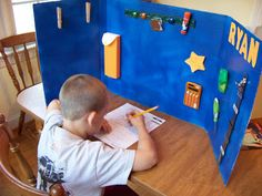 Homework Station!  I love this idea!  Especially for those who don't are able to have a special homework desk or area.  This partition helps define each child's own homework space and helps block distractions. from: http://raisingtomorrowsmen.blogspot.com/2009/09/homework-help.html