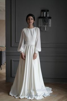 Wedding dress from crepe with chiffon sleeves and beautifull beading on the shoulders.  PRODUCTION TIME Since all our dresses are hand sewn and made to order, kindly allow 2-3 weeks for the making. Rush production options available - if you need the dress for a specific date please let us know and
