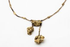 (PHOTO/Titanic -- The Artifact Exhibition) Clearly custom-made. Margaret Brown -- AKA 'The Unsinkable Molly Brown' -- was aboard Titanic. This necklace might have belonged to Brown because her husband had purchased a gold mine in Colorado.