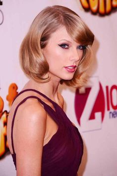 Taylor Swift on the red carpet for the Z100 Jingle Ball // 12.12.14