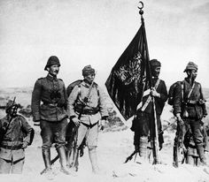 In this 1915 file photo, Turkish soldiers raise their flag at Kanli Sirt, Gallipoli, Turkey during World War One.