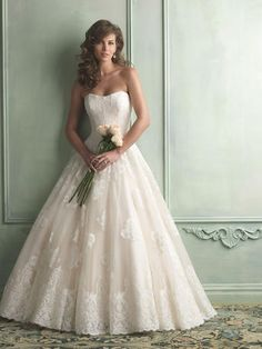 Allure Bridal - 9121 This strapless ballgown features layers of airy English net covered with lace applique. A structured lace bodice offers support……….